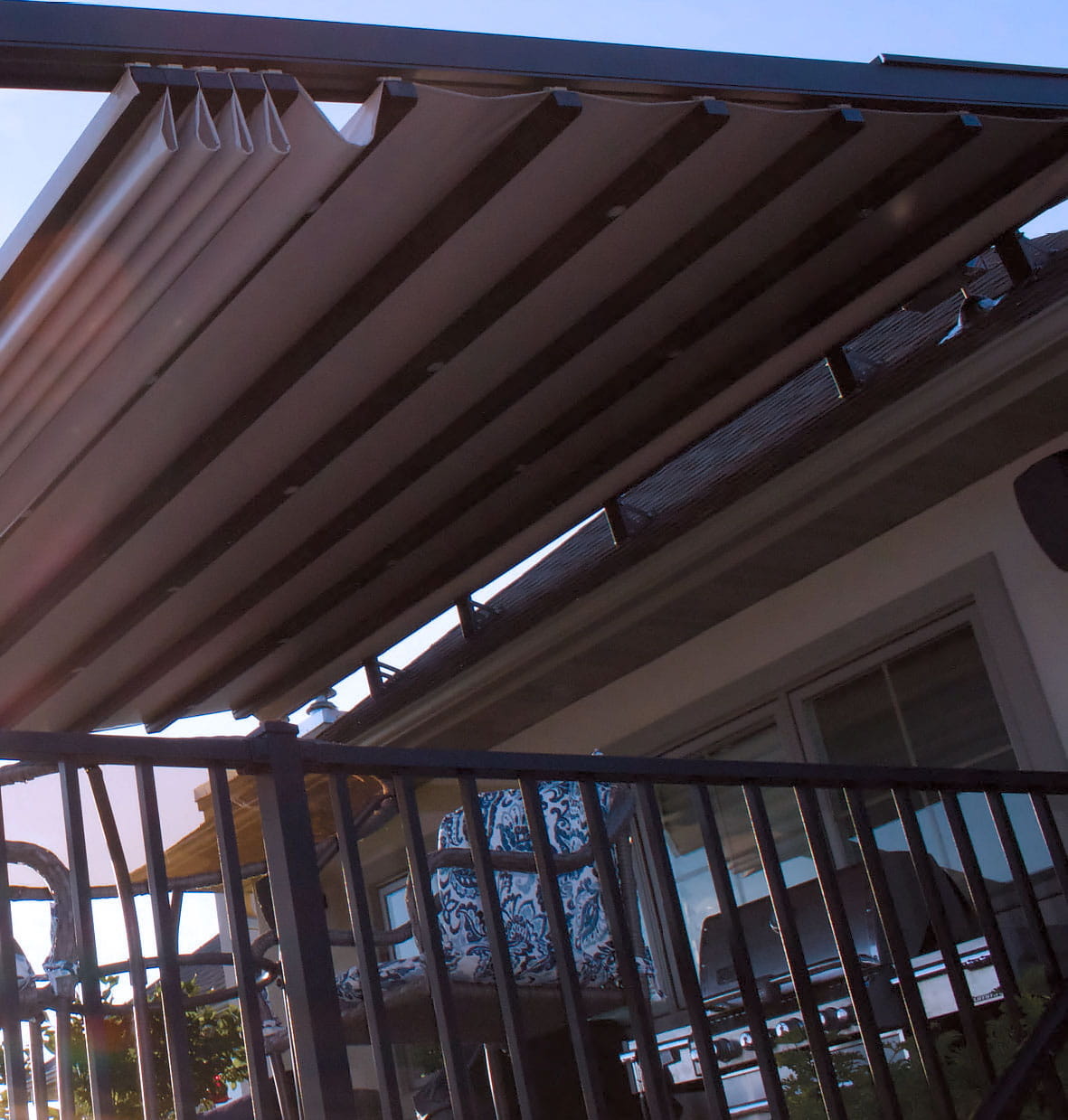 Modern pergola with a Retractable Pergola Cover partially open