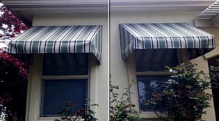 Residential awning to shade windows, striped fabric.