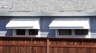 Residential metal window awnings.
