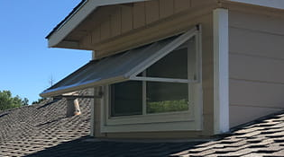 Residential aluminum window awnings tan colored.