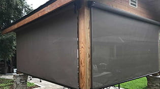 patio with outdoor roller shade screens