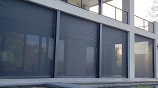 Residential balcony with exterior roller shades